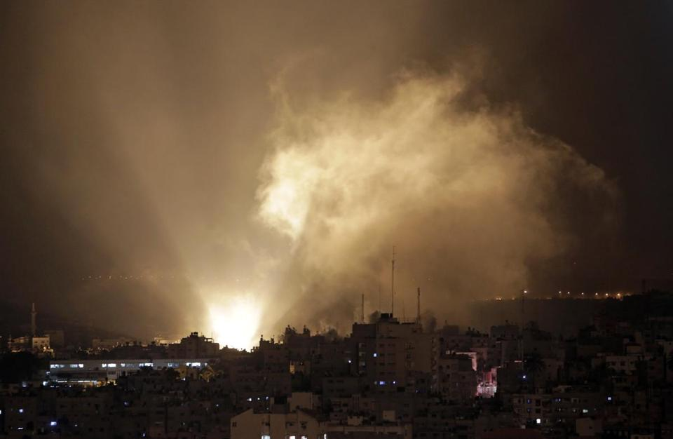 Smoke engulfed parts of Gaza City Tuesday, a day after fighting resumed and lives were lost on both sides of the border.