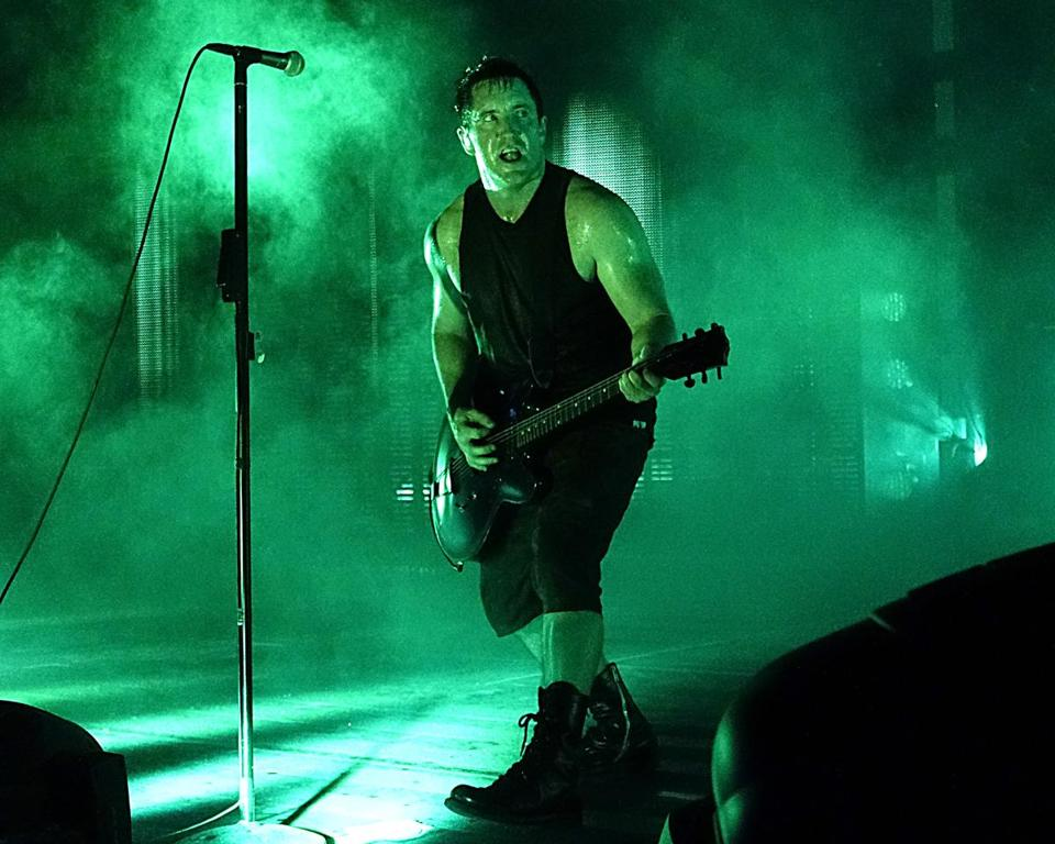 Nine Inch Nails frontman Trent Reznor bobbed and weaved around a stage that switched from minimalism to video overload. (Robert E. Klein for the Boston Globe)