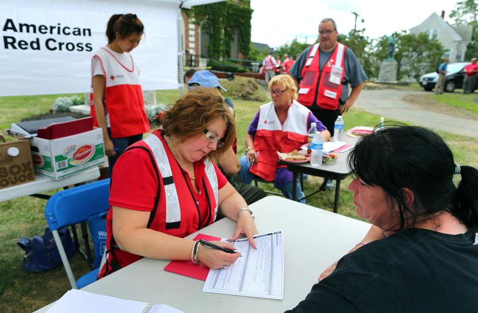 At the American Legion on Broadway, Red Cross volunteer Michelle Santucci took information from resident Renee Bowermaster, who needed assistance after her home on Rose Street was damaged.