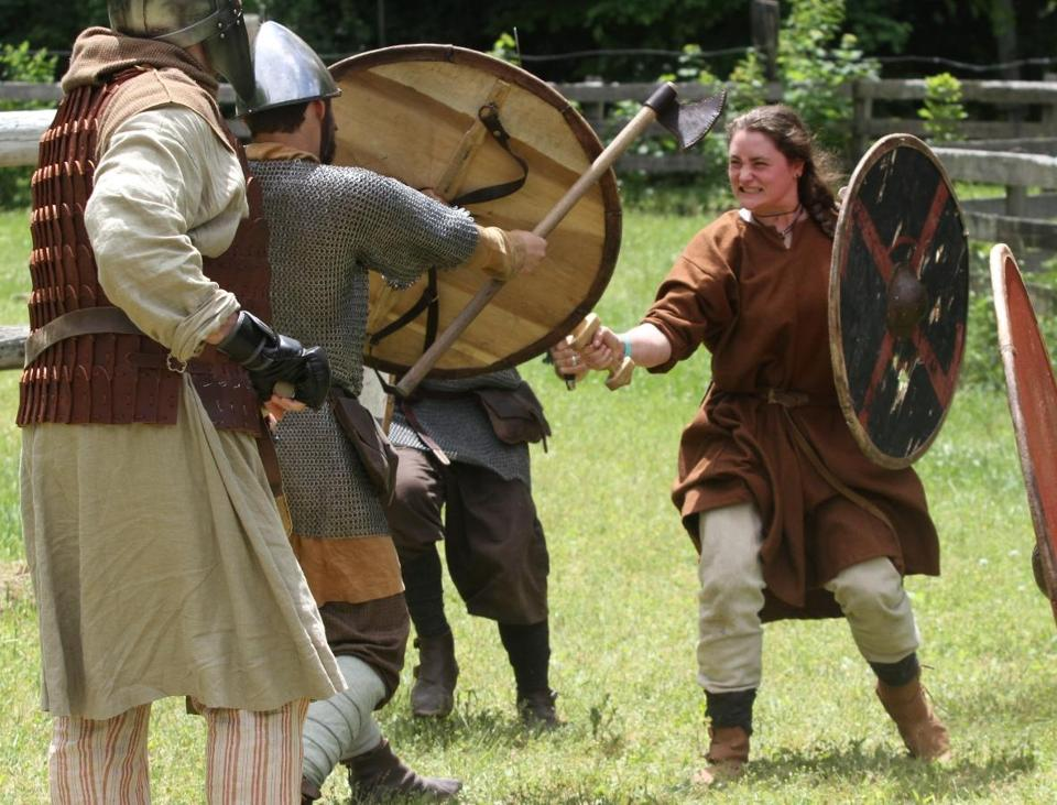 Abbey Miller, as the Draugar Vinlands group's second-in-command Aelfi, takes part in a recent training session at a park in Stratham, N.H., where the Viking history enthusiasts meet on Saturdays.