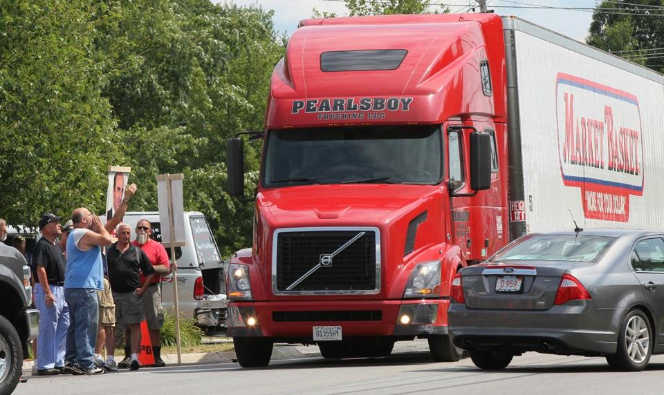 Protesters yelled at a driver of a Market Basket truck during a demonstration at the company's headquarters Wednesday.