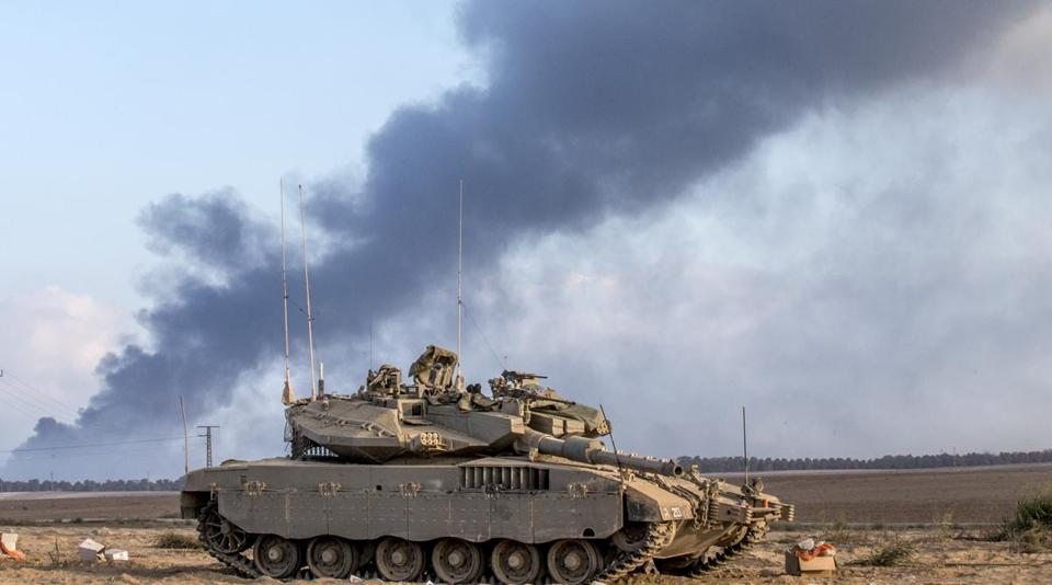 An Israeli tank sat near the border with the Gaza Strip on Thursday as smoke billowed from the coastal Palestinian enclave.