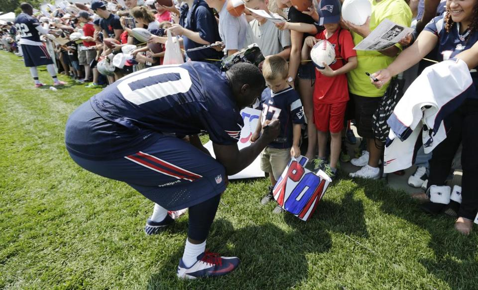 Patriots safety Duron Harmon signed an autograph during training camp last week.