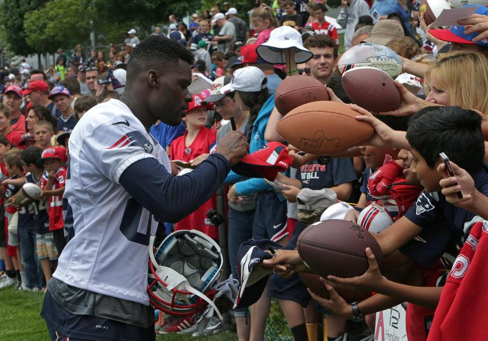 Kenbrell Thompkins signed autographs for fans after a workout early in camp.