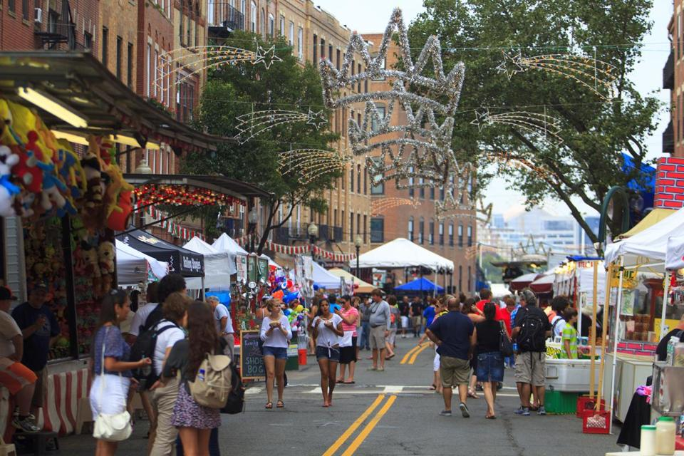 Tourists and residents walked along Hanover Street in Boston's North End Friday during the St. Agrippina di Mineo festival.