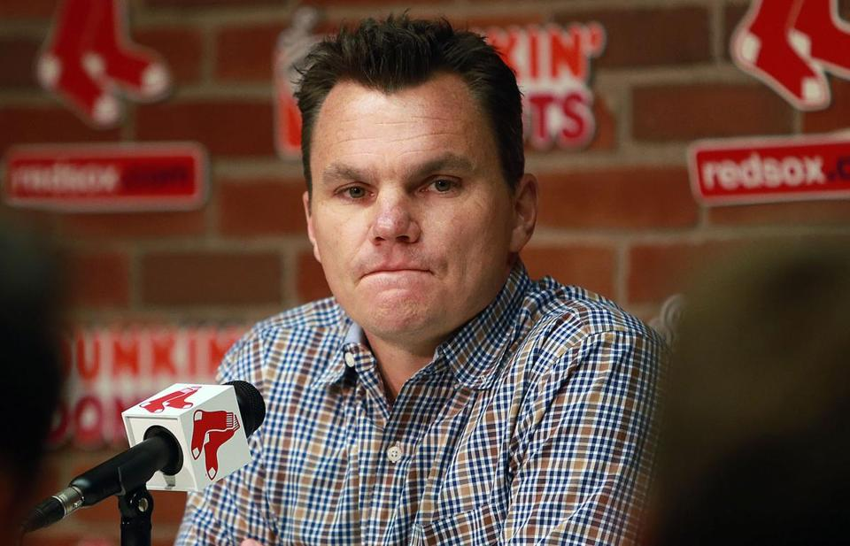 07/31/14: Boston, MA: After a day full of trades, Red Sox general manager Ben Cherington met the media at Fenway Park, and the reporters had many questions regarding the multitude of moves made by the team. Here he pauses as he reflects on a question about how difficult it was to tell Jon Lester that he had been dealt to Oakland. (Jim Davis/Globe Staff) section: sports topic: Red Sox(1)