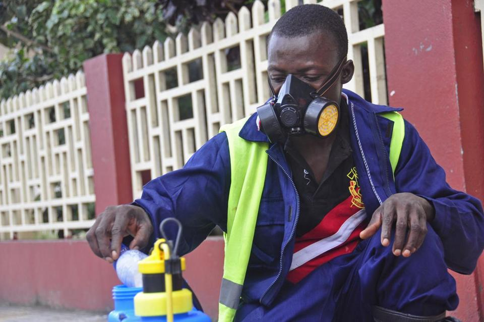 An employee mixed disinfectant before spraying it on the streets in a bid to halt the spread of Ebola in Liberia.