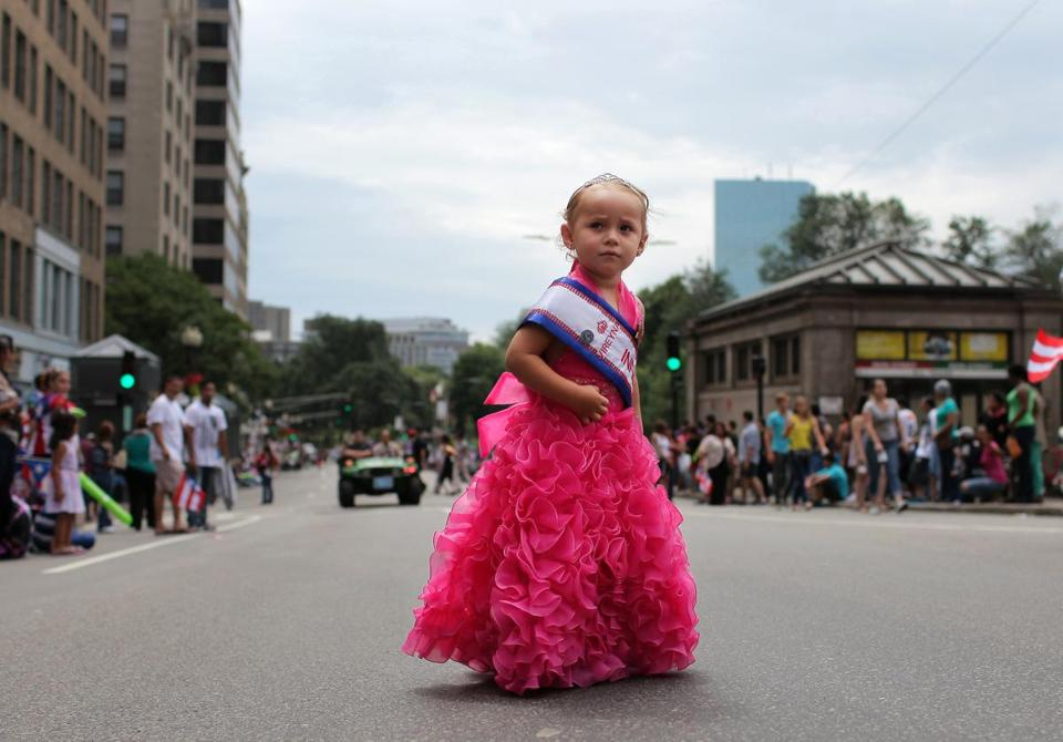 Camila Carrascoza, 3, the co-queen of the Miss New Bedford Latina pageant, walked on Tremont Street during the parade.
