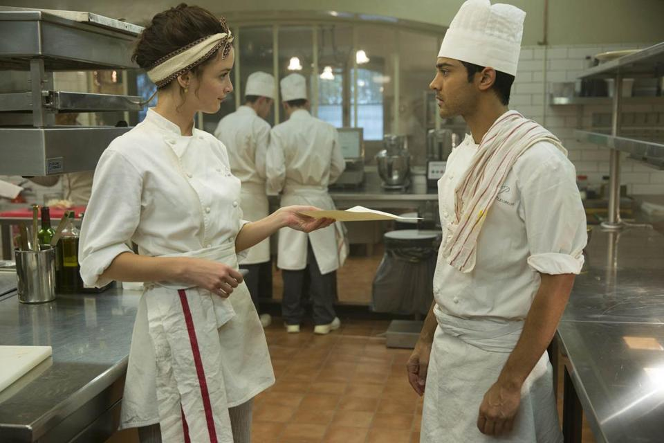 Marguerite (Charlotte Le Bon) and Hassan (Manish Dayal) in the 2014 film THE HUNDRED-FOOT JOURNEY, directed by Lasse Hallstrom. Photo: Francois Duhamel (c) DreamWorks II Distribution Co., LLC. All Rights Reserved.