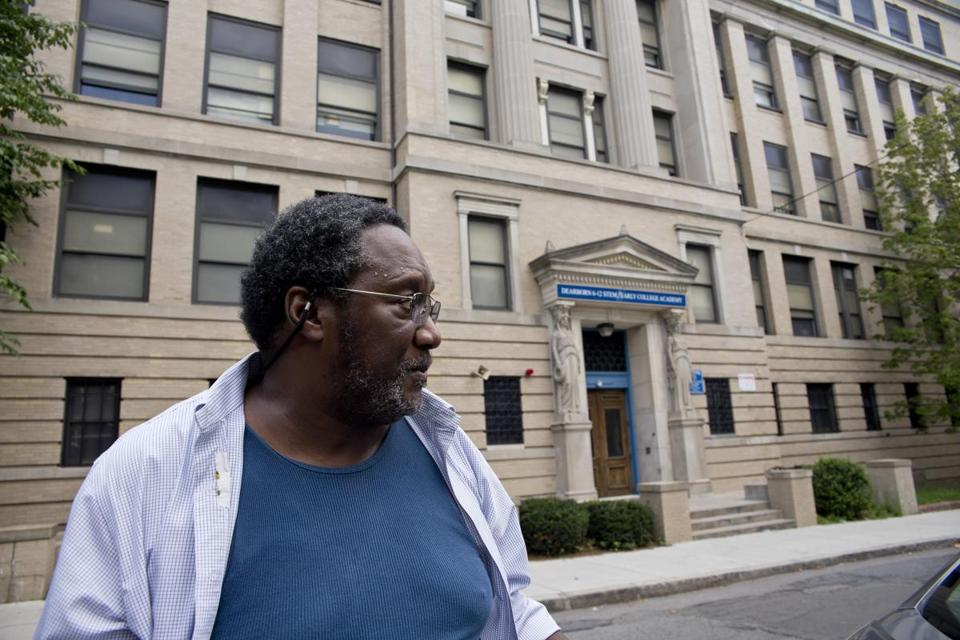After growing up across from the Dearborn, Horace Howard, 63, is among the neighborhood  residents who are hoping to stop the city from tearing it down to make way for a new school.