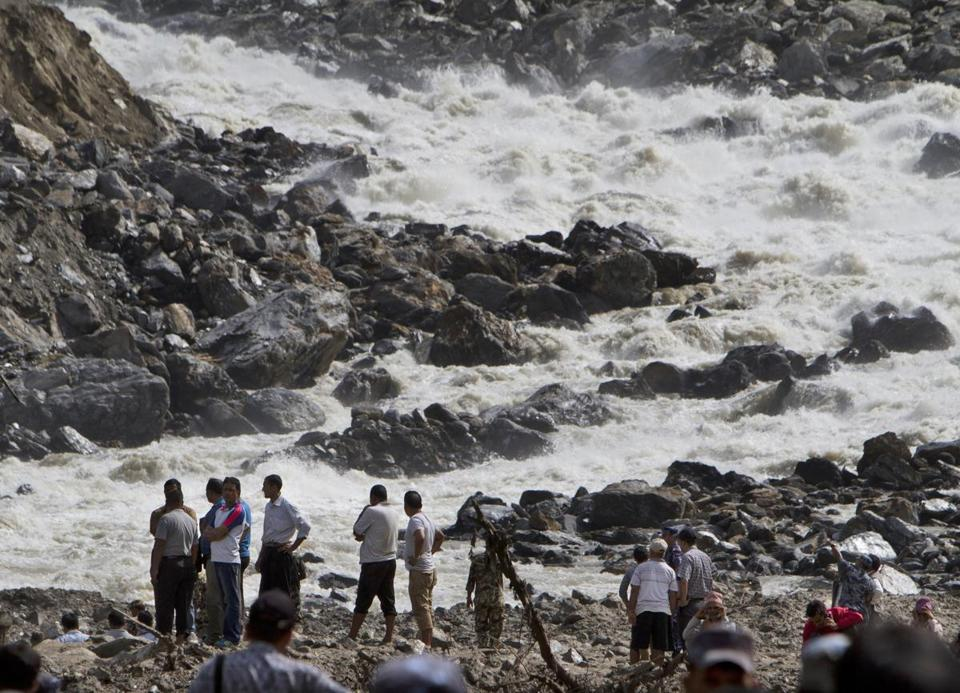 The River Sunkoshi raged on Monday near the site of a massive landslide in Mankha village, east of Katmandu.