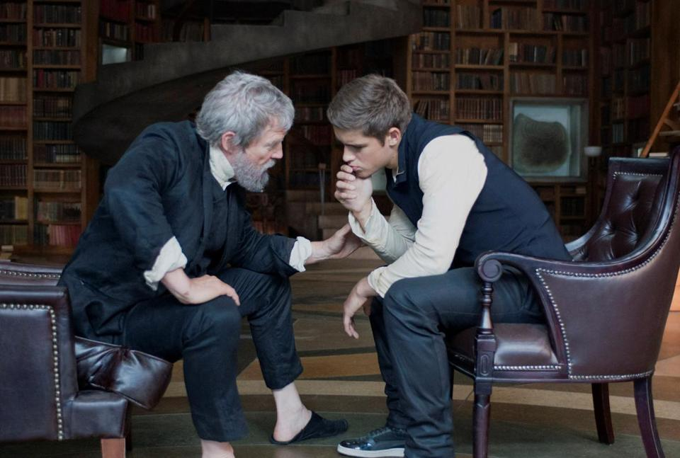 BRENTON THWAITES and ODEYA RUSH star in the 2014 film THE GIVER, directed by Phillip Noyce.