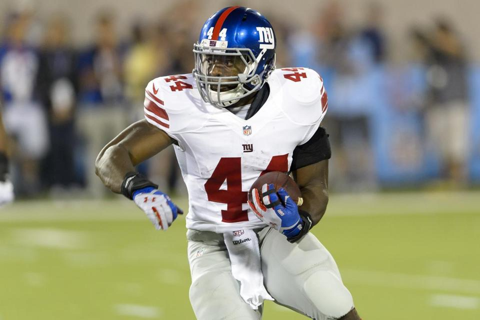 Giants' rookie Andre Williams picks up yardage in the second quarter of the Hall of Fame Game. Jason Miller/Getty Images