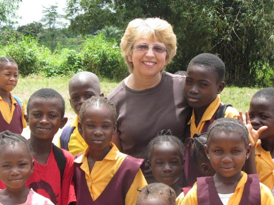 Nancy Writebol is seen with children in Liberia, in a photo from Oct. 7, 2013.