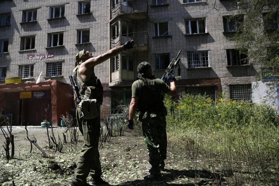 Pro-Russian rebels inspected the damage on Wednesday after a night of shelling in Donetsk, Ukraine.