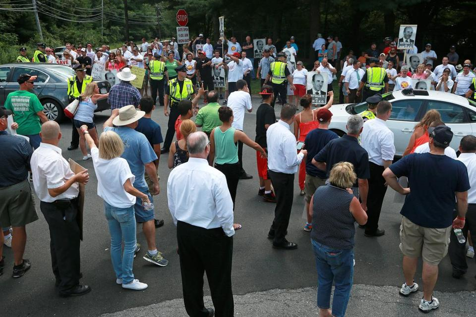 Market Basket protesters made their feelings known as potential employees attended a job fair in Andover Wednesday.