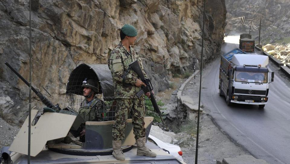 Afghan soldiers guarded a highway near Kabul Wednesday amid tightened security after the US general's killing.