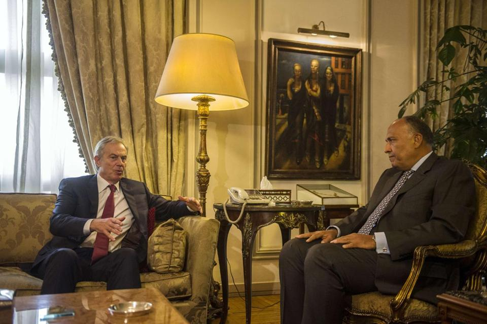 Egypt's Foreign Minister Sameh Shukri, right, meets with Mideast Quartet envoy Tony Blair at the Foreign Ministry in Cairo on Wednesday. Blair -- who represents the European Union, Russia, United Nations and United States -- will hold talks with Egyptian officials.
