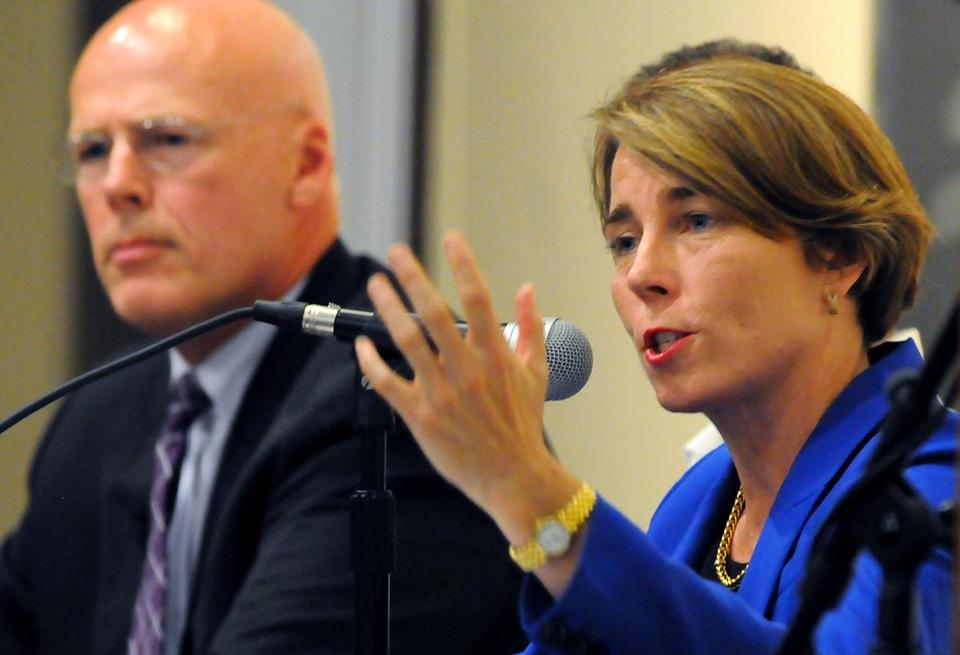 Democratic candidates for Attorney General Warren Tolman (left) and Maura Healey answered questions at a forum in Brockton last month.