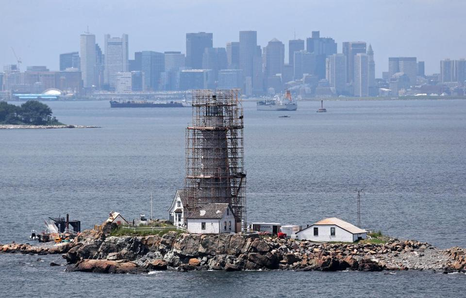 Scaffolding envelops Boston Light on Little Brewster Island as workers renovate the structure and surrounding buildings. The tower was rebuilt in 1783 after the British blew up the original in the Revolutionary War.