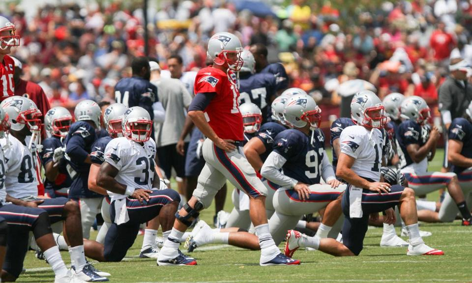 Tom Brady (in red) led the Patriots through another day of drills in Richmond, Va., Tuesday. AP Photo/Skip Rowland