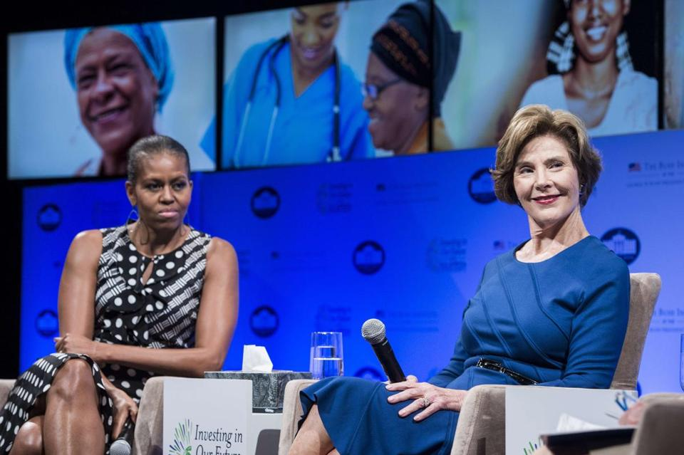 Michelle Obama and Laura Bush hosted a symposium for spouses of African leaders in Washington.