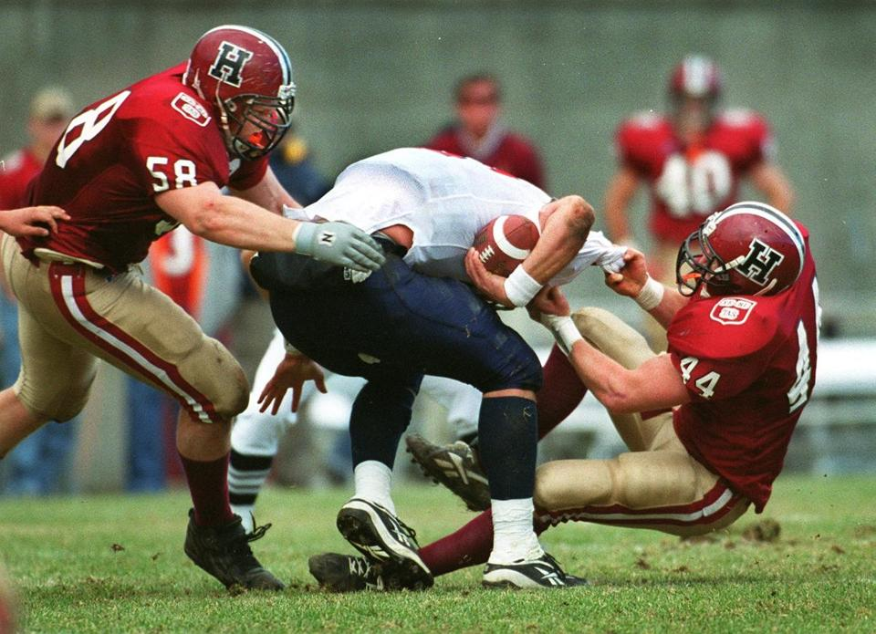 Nowinski, at left, helped sack the Pennsylvania quarterback in a game in 1999.