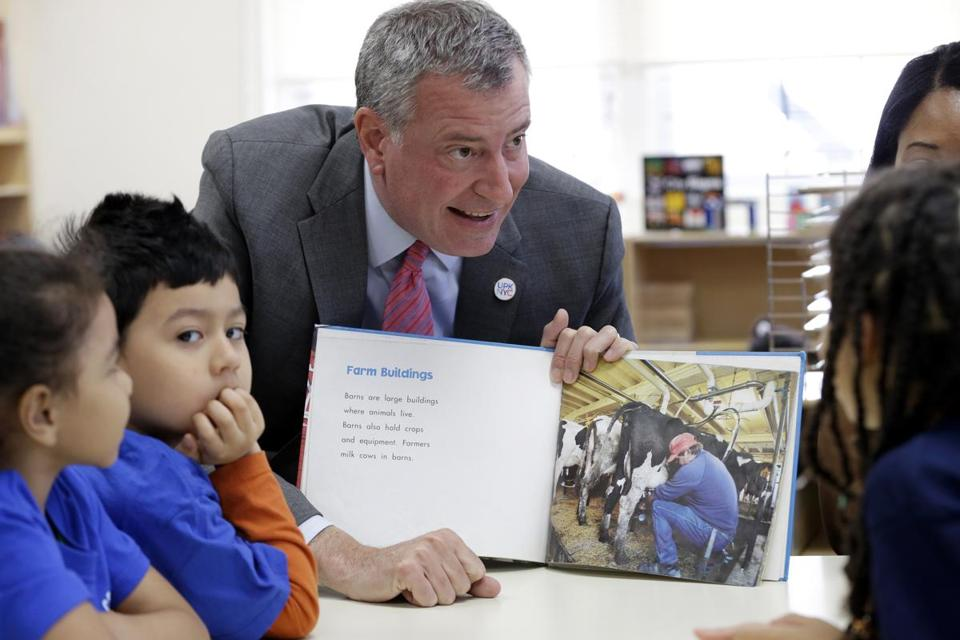 New York City Mayor Bill de Blasio read to children while visiting an education center in Queens.