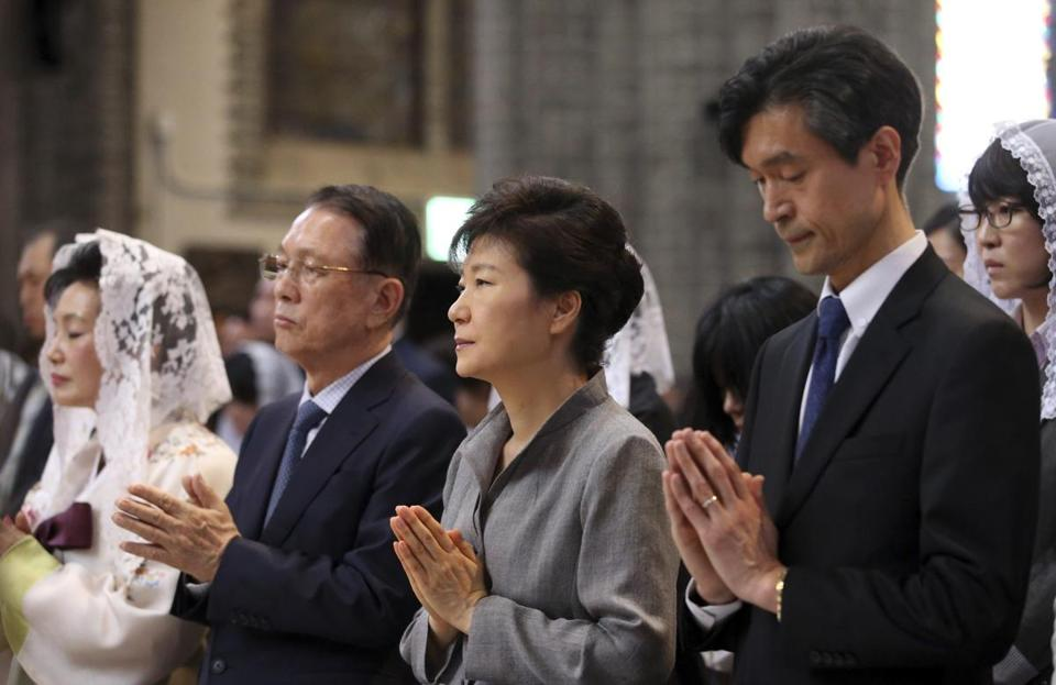 South Korean President Park Geun-hye (second right) attended a Mass in memory of the victims of the sunken Sewol ferry at a Catholic church in Seoul earlier this year.