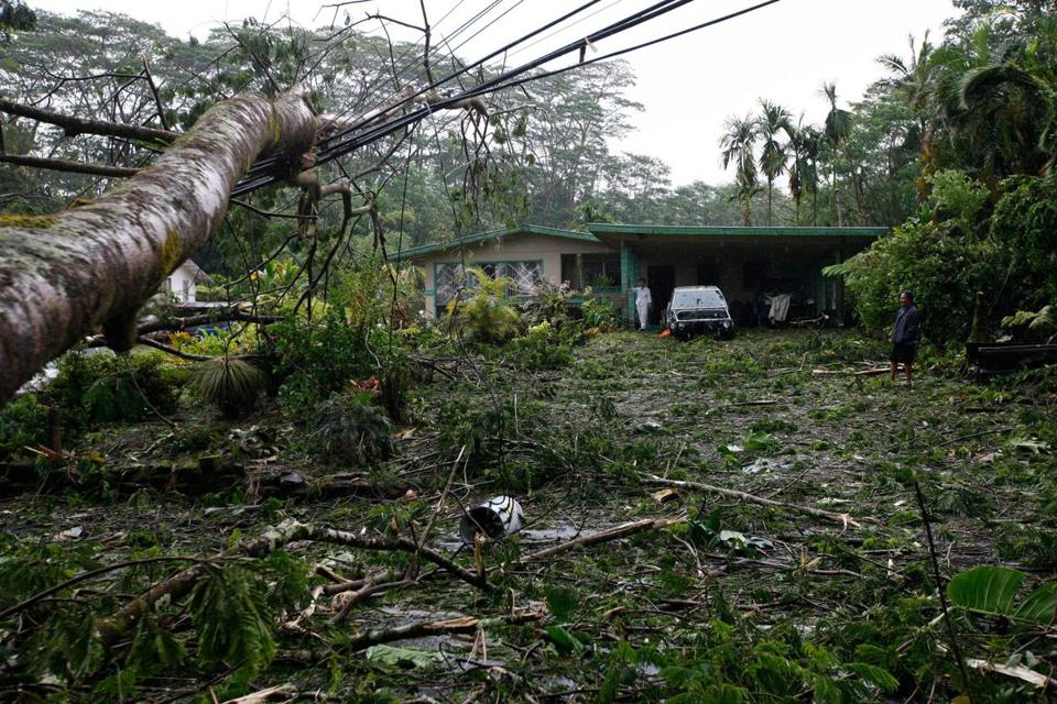 Chris Bulosan and his mother, Catalina, surveyed the damaged caused by Tropical Storm Iselle in Pahoa, Hawaii.