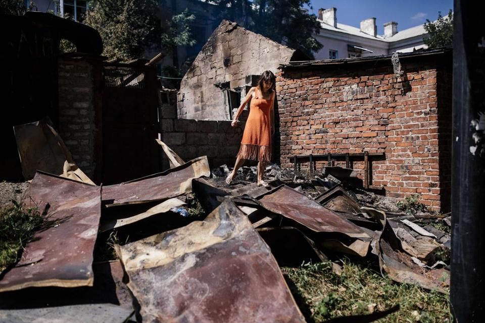 A woman navigated through wreckage after shelling in Donetsk, which became a new battleground in Ukraine.