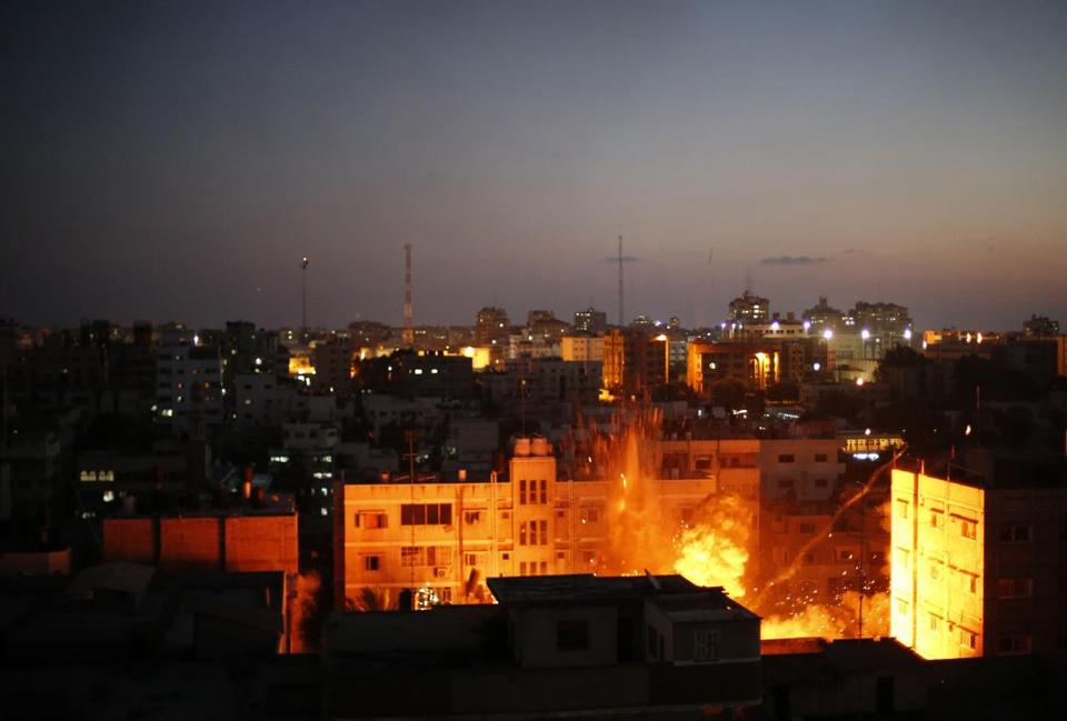 Fire is seen after an explosion in what witnesses said was an Israeli air strike in Gaza City Sunday.