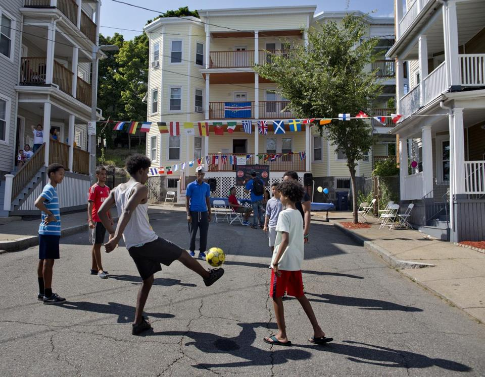 Residents played soccer with 37 Hendry as a backdrop. The renovated three-decker, once the bane of the neighborhood, was the centerpiece of the block party. Mayor Martin J. Walsh attended the event.