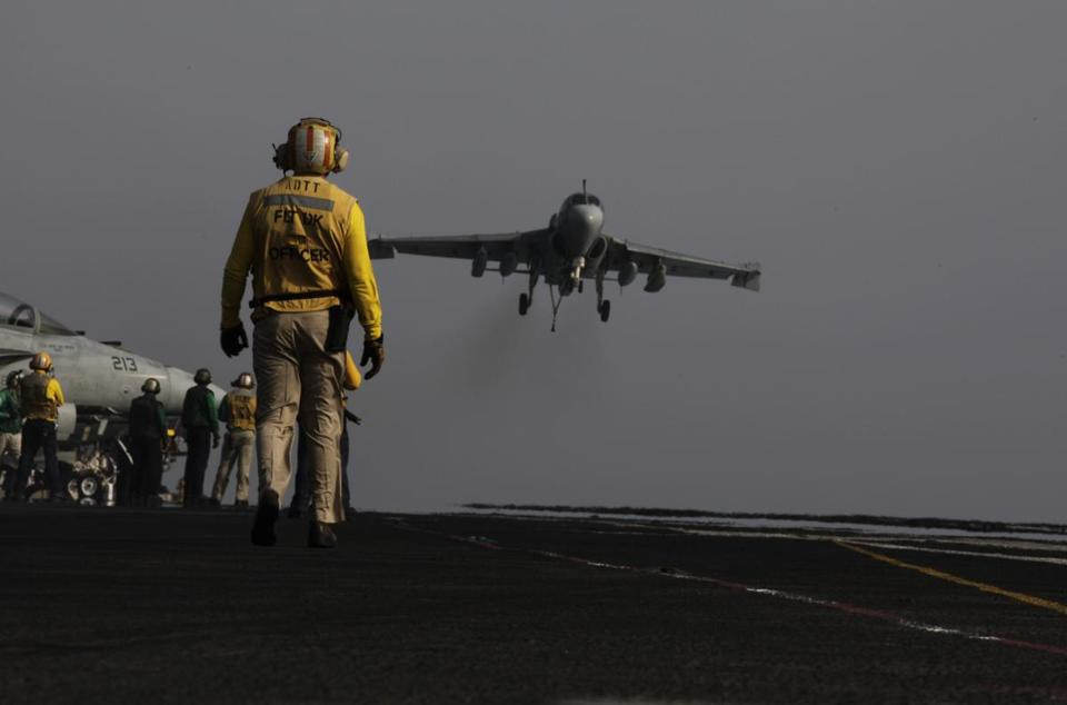 A US military jet coming from Iraq landed on a Navy aircraft carrier in the Persian Gulf after a mission Sunday.