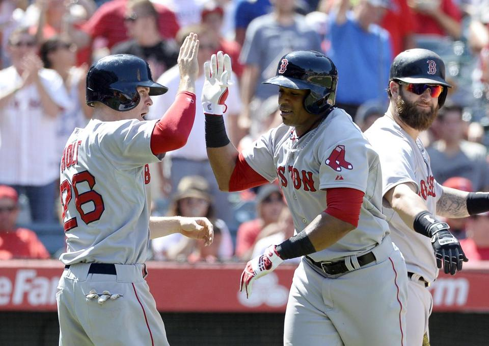 Yoenis Cespedes is congratulated by Brock Holt (26) after Cespedes hit a three-run homer in the eighth Sunday. Richard Mackson-USA Today