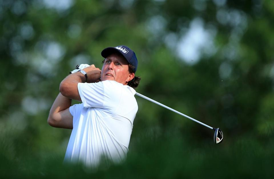 Phil Mickelson hits his drive on the 18th hole Saturday, which he birdied. David Cannon/Getty Images