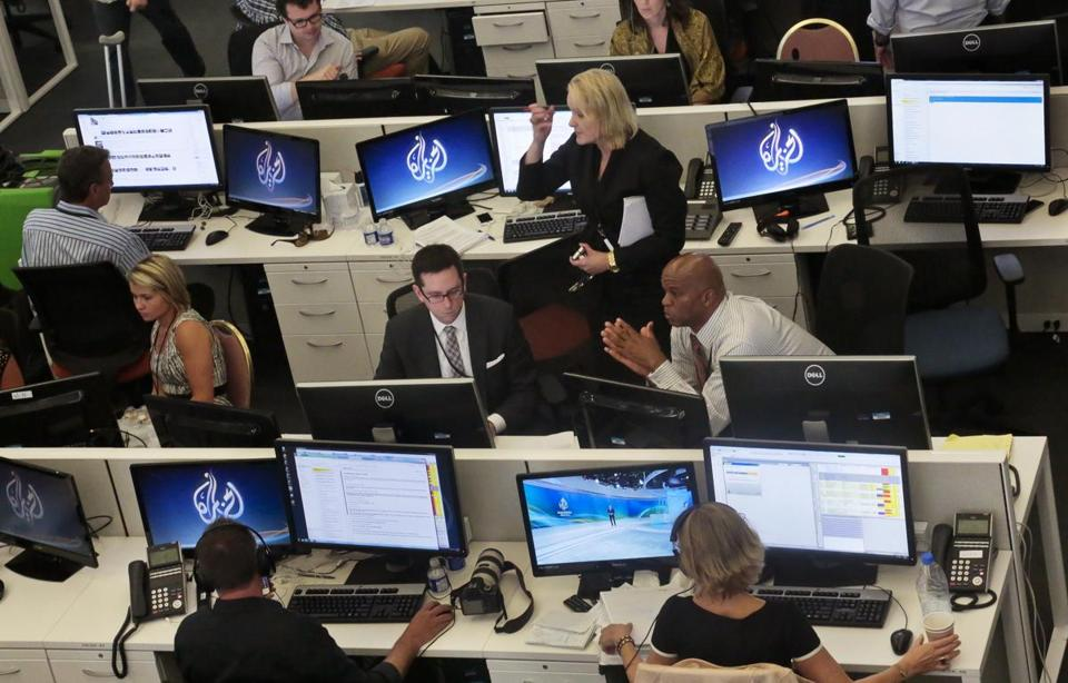 Al-Jazeera America's newsroom staff in New York preparing last summer for the network's first broadcast.