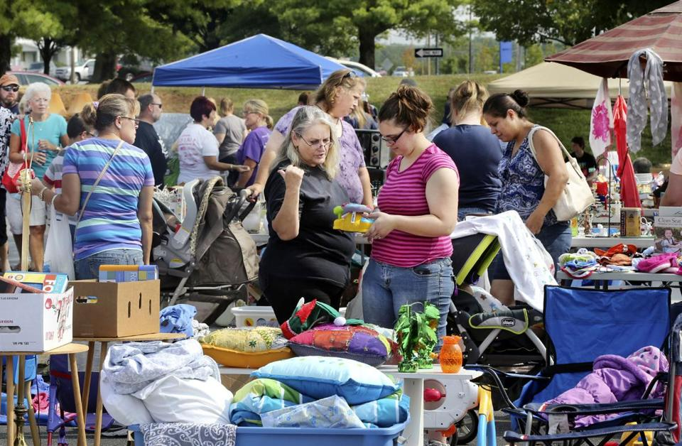 Shoppers looked at items during a festival of yard sales in Virginia.