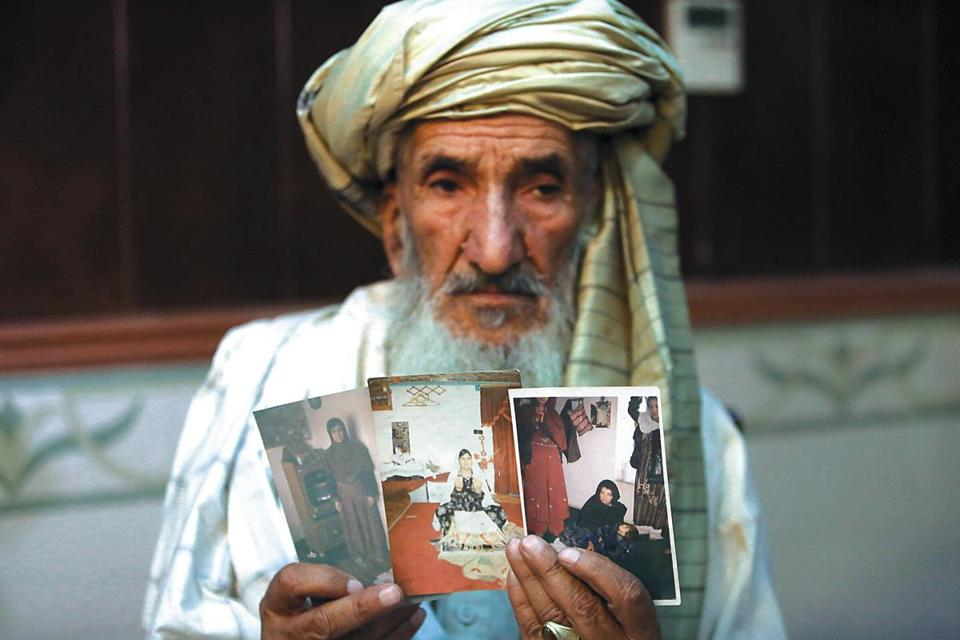 Hajji Sharfddin 67, displayed photographs of relatives, who went missing in 2012, during US military operations in Gardez province, during a news conference in Kabul Monday,