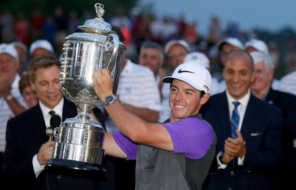 Rory McIlroy celebrated with the Wanamaker trophy after his one-stroke victory Sunday.
