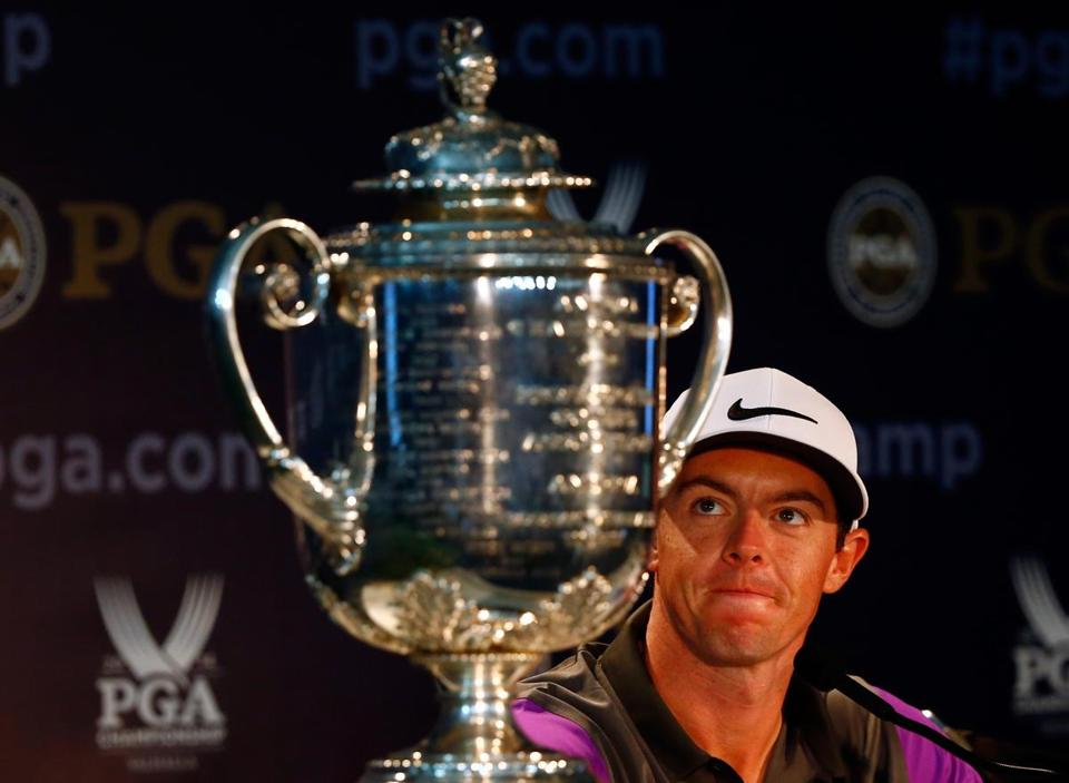 Rory McIlroy admires the Wanamaker trophy after his one-stroke victory Sunday.