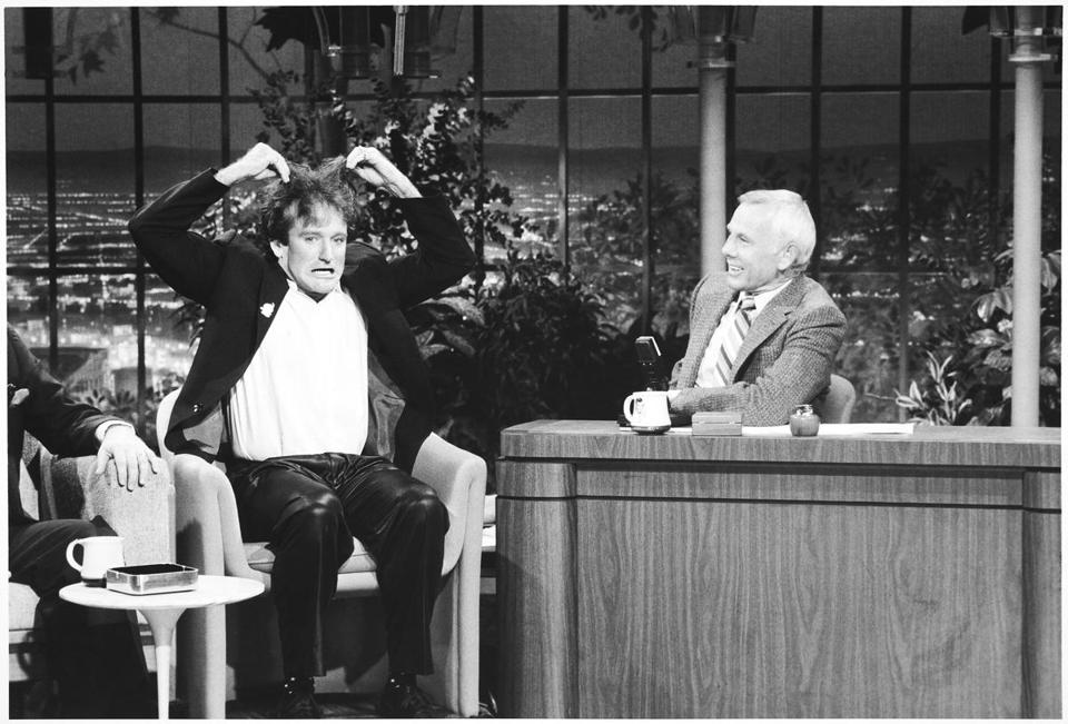Next summer, TCM will launch Carson on TCM a new showcase of memorable interviews collected from Carson's three decades as host of The Tonight Show Starring Johnny Carson. Pictured: Robin Williams and Johnny Carson 11williams