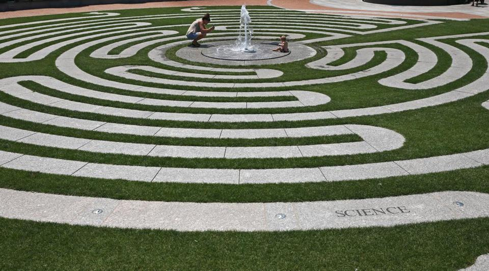 Adrienne Hernandez took a photograph of her 10-month-old daughter Grae Magnolia Hernandez keeping cool by a fountain on the Labyrinth at Armenian Heritage Park on the Rose Kennedy Greenway.