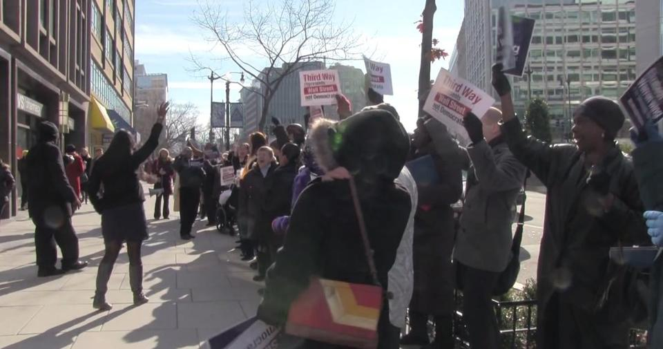 Protesters gathered outside Third Way's offices in Washington, D.C., in December 2013, asking the group to reveal its funding sources.