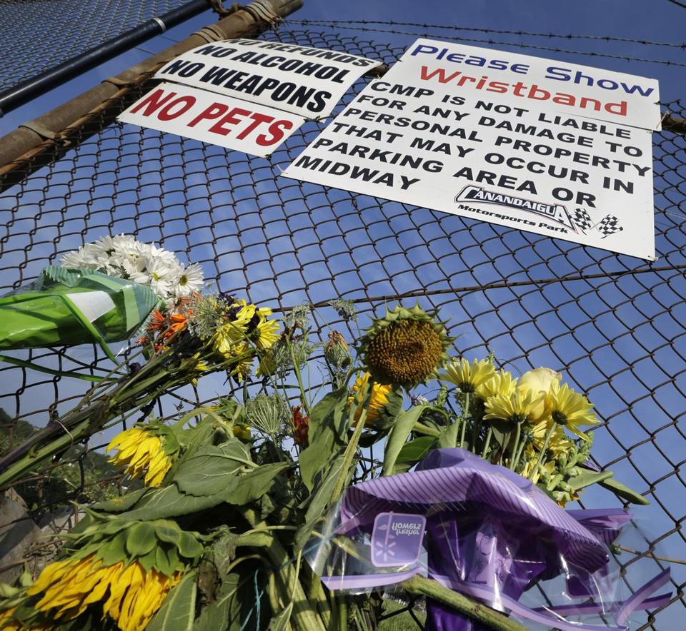 A small memorial of flowers was placed at Canandaigua (N.Y.) Motorsports Park Monday for Kevin Ward Jr., who was killed struck and killed at the track Saturday night. (AP Photo/Mel Evans)