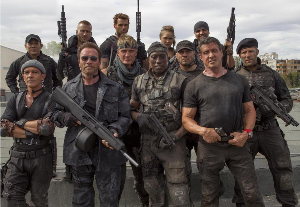 "Sylvester Stallone (center) stood between Randy Couture and Jason Statham on the set of ""The Expendables 3."""