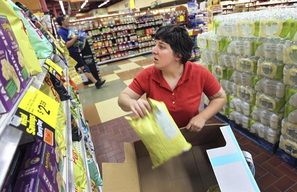 Catherine Maksoiej, an out-of-work cashier at the Market Basket in Manchester, temporarily stocks bags for a potato chip vendor at a Hannford Supermarket in Derry, N.H.