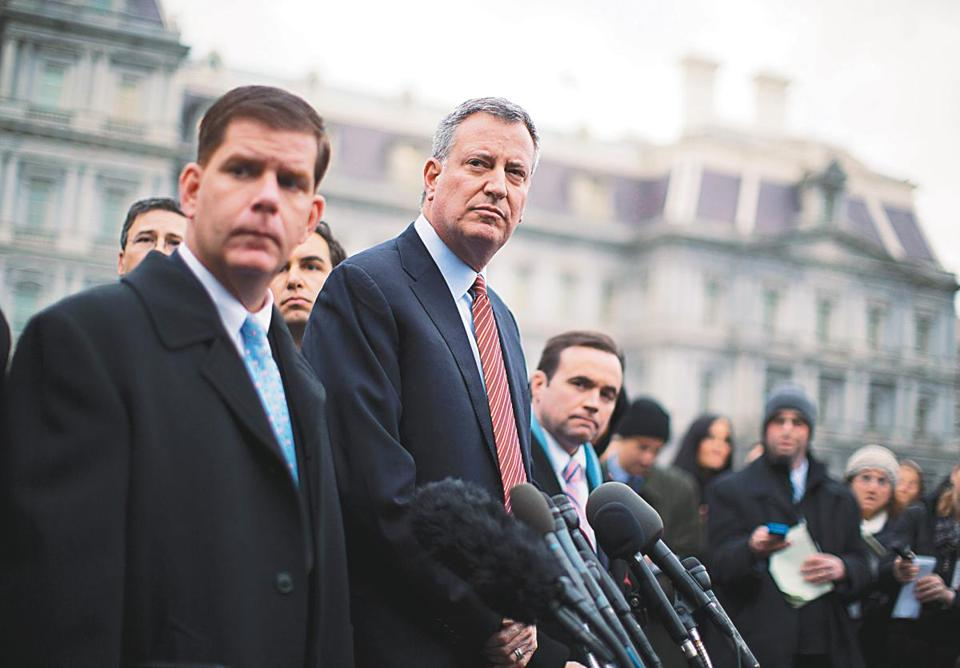 New York Mayor Bill de Blasio and Boston Mayor Martin Walsh were seen following a meeting with President Obama and other newly-elected mayors.