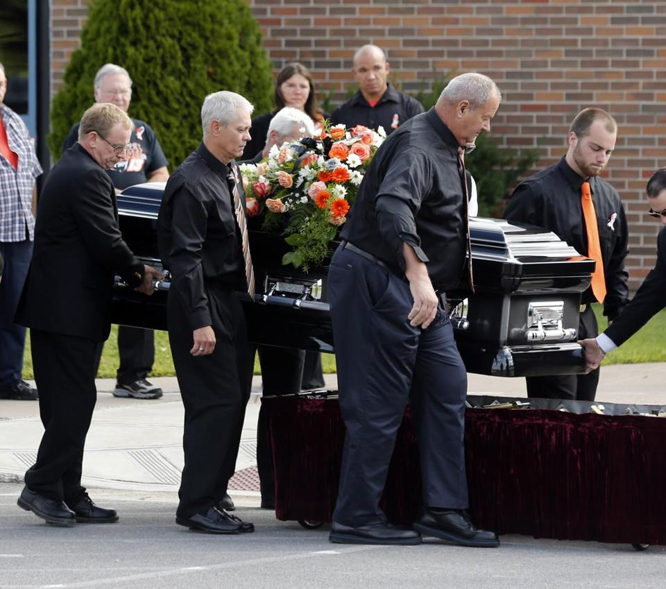 The casket of Kevin Ward Jr. was taken from a hearse before being carried into South Lewis Central School for his funeral.