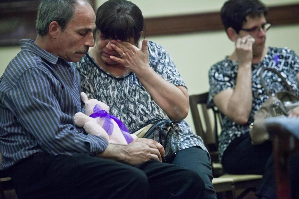 Patty Martel (center) wiped tears from her eyes as she and her husband, Brian Martel (left), mourned their daughter during Friday's memorial service.